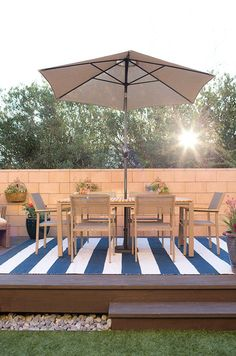 This fabulous floating deck is the centerpiece of a major backyard makeover by Caitlin Ketcham of Desert Domicile. She uses the freestanding deck as an outdoor dining area. This is just one of the amazing details of this low maintenance backyard featured on The Home Depot Blog. || @desertdomicile