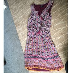 Patterned dress Sleeveless chiffon dress with tassles on it. Never worn! Adorable for a night out! Love reign Dresses