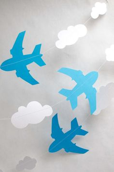 A cool string of blue jet planes and clouds cut from medium weight blue and pearlescent card.