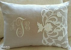 Monogrammed wedding pillow. Taupe linen pillow with ivory monogram is appliqued with a piece from the bride's wedding dress. Back of pillow is embroidered with the wedding date. NellyBelle Designs
