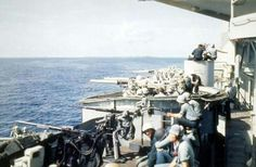 Gun crews of the battleship USS Mississippi (BB-41) take a rest during the attack on Peleliu. Sept. 15, 1944.