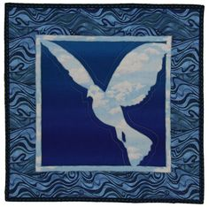Dove quilt by Anne Turner - the silhouette is made with cloud fabric