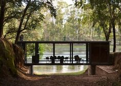Designed by Argentinian firm Alarciaferrer Arquitectos, this modern pad, reminiscent of Philip Johnson's Glass House in northern Argentina near the city of Cordoba, spans a shallow ravine in a eucalyptus forest.