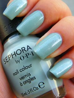 """""""Cartwheels on the Catwalk"""" from Sephora by OPI's Betsey Johnson collection. Topped with Orly's """"Twilight"""" shimmer polish. I abhor Betsey Johnson's """"fashion aesthetic,"""" but I love this pastel smokey turquoise nail polish. Perfect alternative to this season's mint greens, which just don't work with my coloring."""