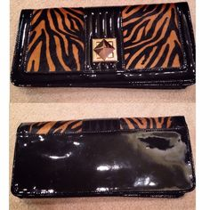 👝WHITE HOUSE BLACK MARKET CLUTCH/PURSE👝 Amazing piece! Used once! Excellent condition! Some marks or scratches. Flaws shown in last picture! Pictures show the whole purse! Can be used as a small bag or clutch and can be converted from one to another! Comes with long gold chain to put over shoulder and tassel! Can fit a lot of small things in this purse. Beautiful gold details! Animal print horse hair is amazing! Soft to the touch. 5x11x1.5 measurements! Great night out piece! Questions?…