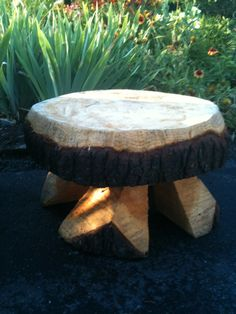 This bench was made from a slice of a tree trunk and legs added from split logs.