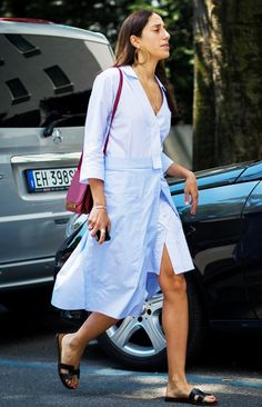 A knee-length dress with a layered wrap-around skirt.