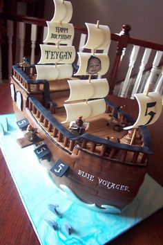 """Captain Teygan's pirate ship - This was my first sculpted cake made for little """"pirate"""" named Teygan.   It remains one of my favorite cakes."""