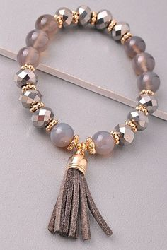 Beaded bracelet with a tassel Stretches - one size fits most