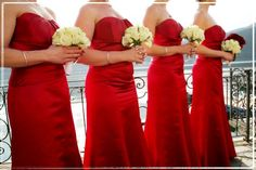 white bouquets for the bridesmaids, Red for the Bride. like this idea, don't like the dresses