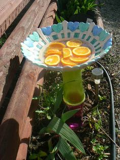 Crafts for the backyard. Glass flower plates,butterfly bath and more.