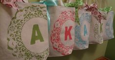 Doily, Paint, Freezer Paper, Canvas Bags.  So cute!  These would be cute to make the girls for the summer.