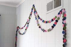 Easy, DIY circle garland. Perfect for filling a big wall in a kid's room or nursery!