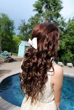 The Only time in my life i have been thrilled with my hair. Perfect color curls and bow. Red brown hair color :)