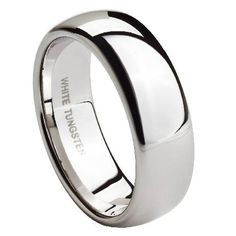 Men's white tungsten wedding bands like this one are an extraordinary development for the jewelry industry. All the strength and durability of tungsten has been transformed into ring that looks just like platinum. This 8mm ring with a slightly domed face is a perfect example of a simple, classic band that shows off the natural beauty of white tungsten.  Web Page: http://www.justmensrings.com/Mens-White-Tungsten-Wedding-Band-with-Polished-Finish-8mm--JTG0061_p_452.html