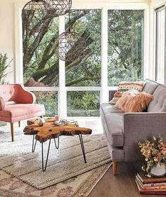 Fall Decorating Tip: In a large space, use multiple rugs to define the conversation area.