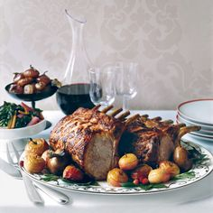 Citrus-Marinated Pork Rib Roast Recipe from Food & Wine.Perfect Christmas Roast: Chef Fabio Trabocchi infuses this pork roast with flavor by stuffing garlic cloves into the fatty side of the roast and marinating the meat with fresh herbs and citrus. Marinated Pork Ribs, Pork Rib Roast, Rib Roast Recipe, Roast Recipes, Wine Recipes, Cooking Recipes, Recipes Dinner, Dinner Ideas, Italian Christmas Dinner