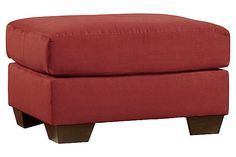 "The Darcy - Salsa Ottoman from Ashley Furniture HomeStore (AFHS.com). With the exciting contemporary style of the sweeping padded arms and plush pillow back design, the sleek beauty of the ""Darcy-Salsa"" upholstery collection is sure to awaken the décor of any home environment while offering the comfort that you have been searching for."
