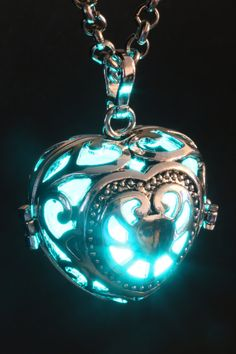 Fairy Punk Jewelry - Necklace - Heart Locket with teal blue glowing Orb These gorgeous Fairy Punk Locket pendant features a pulsing led orb powered by replaceable batteries. Punk Jewelry, Heart Jewelry, Jewelry Accessories, Jewelry Necklaces, Fashion Jewelry, Unique Jewelry, Dainty Jewelry, Pandora Jewelry, Gold Jewelry