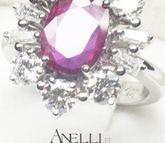 Anello in Platino 950 con Rubino centrale e Diamanti laterali..