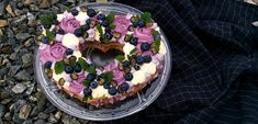 Cream tart cake made of almond cashew linzer cookie dough and lemon blueberry buttercream