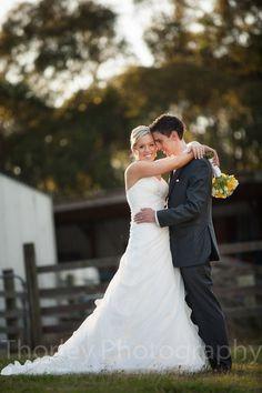 Bride and groom in embrace at Yarra Ranges Estate.