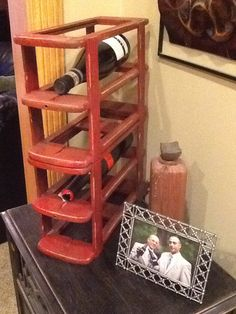Wine caddy made from the outsides of a sewing machine drawer. Nailed them together, painted it red and distressed... Darling!
