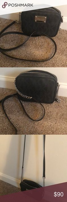 Small black Michael Kors cross body purse. Small black Michael Kors cross body. Slightly used but no physical ware. No tags. Just like new condition. Michael Kors Bags Crossbody Bags