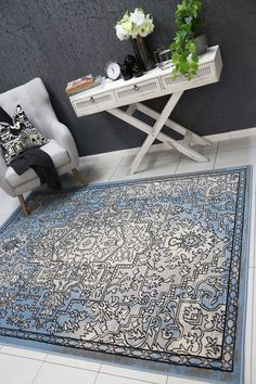 Runiullae Distressed Vintage Light Grey Light Blue Rug A marvelous exhibit of trendsetting rugs, this Collection instills life into extraordinary spaces. Expertly power-loomed in Turkey, these rugs are easy-care and virtually non-shedding. Classic designs become fashion-smart home decor in this alluring and playful collection.