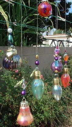 nail polish + recycled lightbulbs for garden art