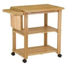 Create extra storage in your kitchen with this Winsome Basics Kitchen Cart. It is made of solid, composite wood, which ensures strength and durability. It has a beech finish. This kitchen cart features two storage shelves. It is topped with a spacious table top with a cutting board, which provides a great surface cutting vegetables and preparing food. It has an in-built towel rack for you to hang your towels. It also has a knife block to stack your knives. This Basics Kitchen Cart by Winsome…