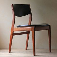 Classically elegant teak chair; angled back and leather covers. Mid-century design and always stylish.