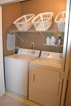 shelves hung out over the laundry machines for soap and supplies and to baskets up off the dirty floor