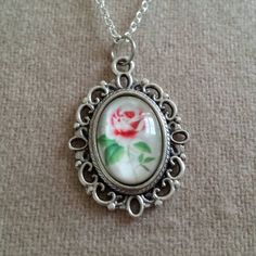 Check out this item in my Etsy shop https://www.etsy.com/listing/239840159/roses-picture-locket-pendant-necklace
