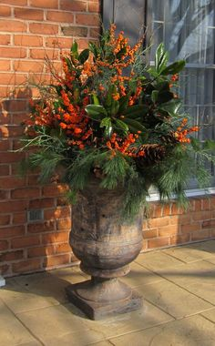 containers and urns with fresh greens are the perfect solution for winter gardens