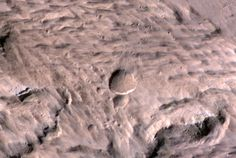 Large, Fresh Crater Found on Mars - The crater at the center of this May 9, 2014, image is 159 feet (48.5 meters) wide. It resulted from an impact that occurred in the interval between daily Mars-afternoon observations on March 27 and March 28, 2012, as determined from before-and-after observations of a large impact scar and of the largest and second-largest craters. It is the biggest fresh impact crater anywhere -- not just on Mars -- ever clearly confirmed by before-and-after images.
