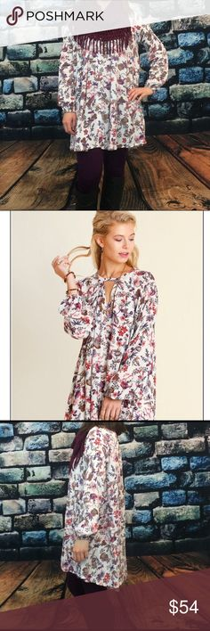 """Plus Size Ivory Floral Trapeze Dress Beautiful ivory floral trapeze dress featuring keyhole neckline with button closure. Long sleeves with elastic feature at bottom of sleeves and towards the top. Model is 5'6"""" wearing a size S. Dresses Long Sleeve"""
