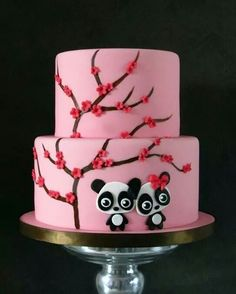Pink cake with cherry blossoms pandas.