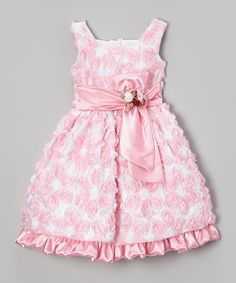 Little ladies will revel in the charming style of this party-perfect dress. Boasting a big bow sash, easy-on back closure and elegant A-line silhouette, this piece pulls out all the precious stops.