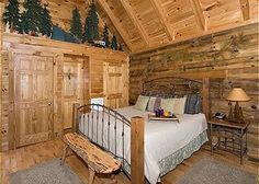 Sunset Thrill in Pigeon Forge TN. It has high beamed ceilings and clerestory windows which allow ample natural light to shine throughout the cabin. In this studio style layout, the bedroom, living room and full kitchen area are all combined creating a cozy ambiance.