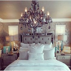 True Hollywood glam look with the gorgeous chandelier, silver, and touch of turquoise. Love this look.