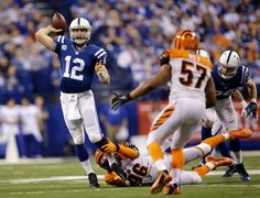 Bengals Colts Football Carlos Dunlap, Andrew Luck