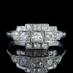 A glamorous Art Deco inspired cluster ring modelled in solid Platinum and decorated with a combination of Brilliant cut, Baguette cut and Emerald cut Diamonds across the face with five old European cuts running across the centre. Antique Diamond Rings, Antique Engagement Rings, Vintage Diamond, Emerald Cut Diamonds, Diamond Cuts, Perfect Engagement Ring, Old Stone, Diamond Sizes, Diamond Cluster Ring