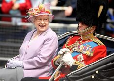 The smile that says it all: Her Majesty shares a lighter moment with her husband at Troop...