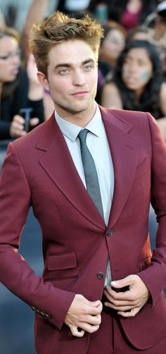 Um yeah, who would have thought that a maroon suit would look this good?? It helps when you have this man for a hanger.