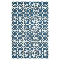 Hand-tufted wool rug with a Moroccan tile motif.  Product: RugConstruction Material: WoolColor: Navy and ivoryFeatures:  Hand-tuftedMade in India  Note: Please be aware that actual colors may vary from those shown on your screen. Accent rugs may also not show the entire pattern that the corresponding area rugs have.Cleaning and Care: Professional cleaning recommended