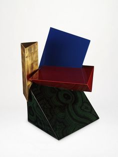"Fred Baier ""Prism"" Chair (circa 1994). It's like ""dark side of the moon"" (Pink Floyd) meeting Ettore Sottsass in the 90's. Its extraordinary.... but that's what it is!!! Designed to be so."