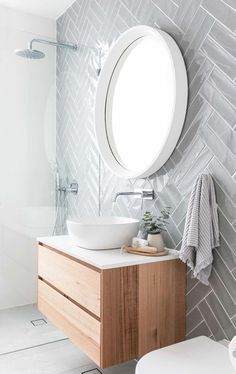 Coastal Home Interior Grey herringbone subway tile on modern bathroom with floating vanity, white vessel sink and round mirror Bathroom Renos, Laundry In Bathroom, Small Bathroom, Bathroom Remodeling, Modern Bathroom Mirrors, Bathroom Subway Tiles, Round Bathroom Mirror, Modern White Bathroom, Modern Bathrooms
