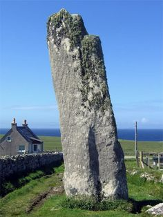 Clach-an-Trushal - The largest standing stone in Scotland standing over 6 metres tall. Mesolithic Scotland ~ This looks like a giant hand and arm reaching toward the heavens. England And Scotland, Scotland Uk, Cairns, Outer Hebrides, Monuments, Scottish Highlands, Scotland Travel, British Isles, Great Britain