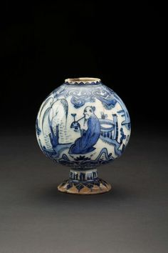 Safavid fritware globular vase Iran, First half of the 17th century The globular body on a high foot is painted in cobalt blue on a white gound with a Chinese sage sitting in a landscape smoking a huqqa pipe. 11.4cm high
